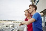 Happy couple on observation deck at the airport - RHF02242