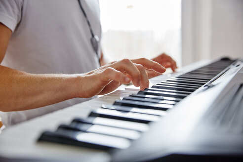 Hands of man playing digital piano - RHF02269
