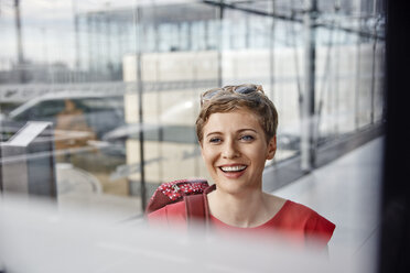 Portrait of happy woman at the airport - RHF02287
