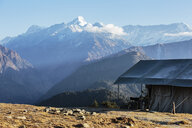Yurt overlooking majestic mountain range, Jaikuni, Indian Himalayan Foothills - HOXF03946