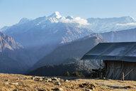 Yurt overlooking majestic mountain range, Jaikuni, Indian Himalayan Foothills - HOXF03946
