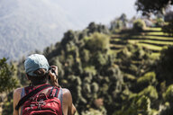 Female hiker looking at view, Supi Bageshwar, Uttarakhand, Indian Himalayan Foothills - HOXF04168