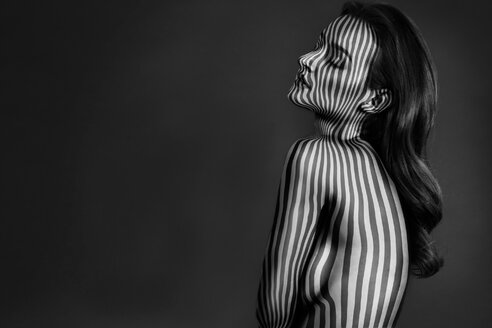 Shirtless young woman covered in striped pattern - LUXF01933