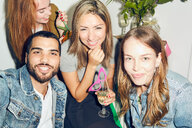 Portrait of smiling young multi-ethnic friends enjoying party at apartment - MASF09604