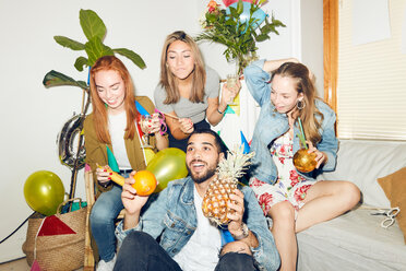 Young multi-ethnic friends enjoying dinner party at home - MASF09607