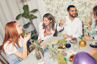 High angle view of young multi-ethnic friends enjoying dinner party at home - MASF09697