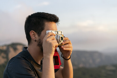 Spain, Barcelona, Natural Park of Sant Llorenc, man taking a picture of the view - AFVF01895