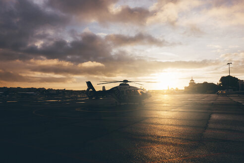 Helicopter on landing place during sunset - OCMF00008
