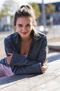 Portrait of smiling young woman outdoors - UUF15741