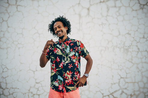 Portrait of dancing man wearing shirt with floral design - OCMF00033