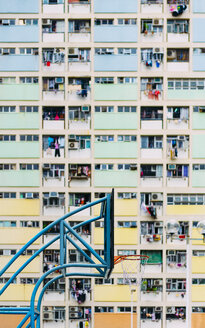 China, Hong Kong, Kowloon, basketball hoop, public housing in the background - GEMF02436