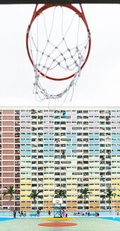 China, Hong Kong, Kowloon, basketball hoop, public housing in the background - GEMF02439
