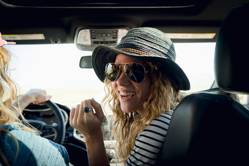Woman Wearing Sunglasses While Sitting By Man In Car - TGBF00959