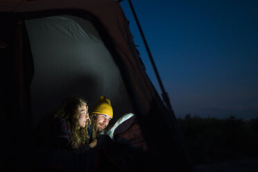 Young Hikers Resting In Tent At Night - TGBF00995