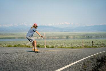 Man Skateboarding On Road Against Sky - TGBF00998