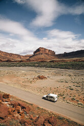 High angle view of motorhome on road with mountains in background at Moab - TGBF01025