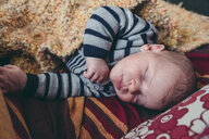 High angle view of baby boy sleeping on bed at home - CAVF52469