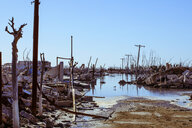 Demolished buildings against clear blue sky during Hurricane Harvey - CAVF52571