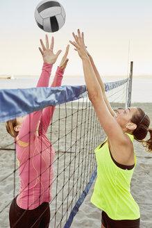 Women playing beach volleyball - TGBF01257