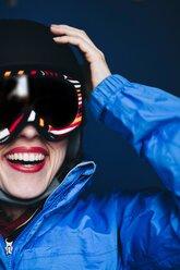 Woman with ski helmet and ski goggles - INGF05409