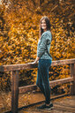 Full length shot of a young woman posing in the autumn - INGF05532