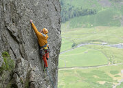 United Kingdom, Lake District, Langdale Valley, Gimmer Crag, climber on rock face - ALRF01355
