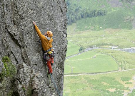 United Kingdom, Lake District, Langdale Valley, Gimmer Crag, climber on rock face - ALRF01355