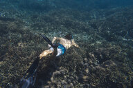 Shirtless man snorkeling undersea - CAVF52804