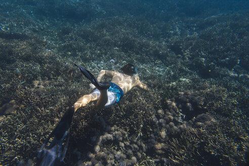 Shirtless man snorkeling undersea - CAVF52804