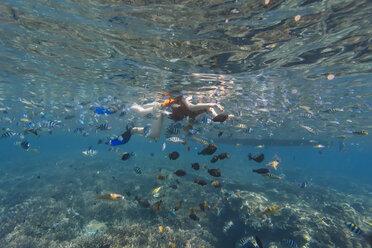 Woman snorkeling in sea - CAVF52807