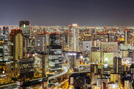 High angle view of illuminated modern buildings against sky at night - CAVF53022
