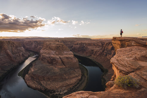 USA, Arizona, Colorado River, Horseshoe Bend, young man standing on viewpoint - KKAF02841