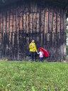 Austria, Tiyol, Jochberg, mother and daughter in rain - PSIF00147