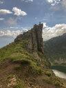 Austria, Tyrol, Fieberbrunn, woman in mountainscape - PSIF00150