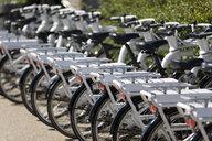 Denmark, Copenhagen, row of rental bikes - KLRF00730