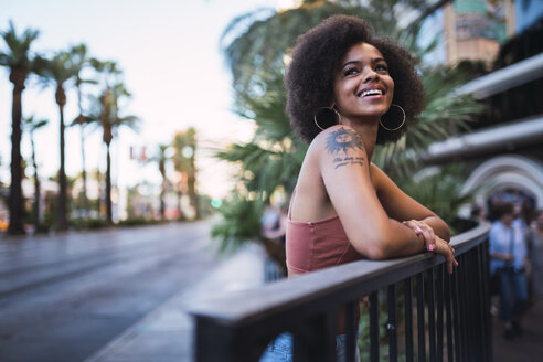 USA, Nevada, Las Vegas, portrait of happy young woman in the city - KKAF02884