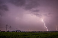 Powerful lightning in the sky over a field - INGF06179