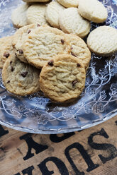 High angle close up of chocolate chip cookies on a glass plate. - MINF09343