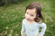 High angle portrait of cute girl standing on field at park - CAVF53292