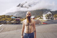 Norway, Lofoten, portrait of shirtless man with full beard - RSGF00060