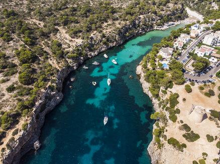 Spain, Balearic Islands, Mallorca, Llucmajor, Aerial view of bay of Cala Pi and Torre de Cala Pi - AMF06164