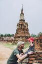 Thailand, Ayutthaya, Father and baby girl in the ancient ruins of Wat Mahathat temple - GEMF02471