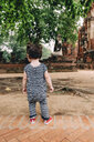 Thailand, Ayutthaya, Baby girl exploring Wat Mahathat temple - GEMF02483