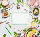 High angle view of an ipad on a table surrounded by fresh food - INGF06345