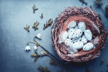 High angle view of eggs in a wicker basket - INGF06463
