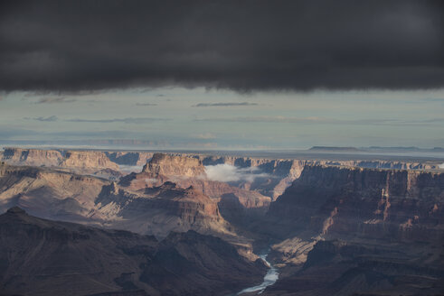 High angle scenic view of rock formations against stormy clouds at Grand Canyon National Park - CAVF53983