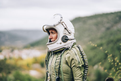 Woman in space suit exploring nature - OCMF00085