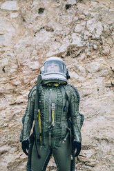 Woman in space suit exploring nature - OCMF00088