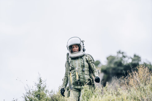 Woman in space suit exploring nature - OCMF00091