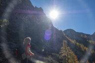 Germany, Bavaria, Upper Bavaria, Berchtesgadener Land, Berchtesgaden National Park, female hiker against the sun - HAMF00528